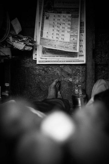 Napping Coco Vendor, India - Erin J. Bernard