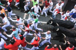 Running of the bulls; Pamplona, Spain - Erin J. Bernard